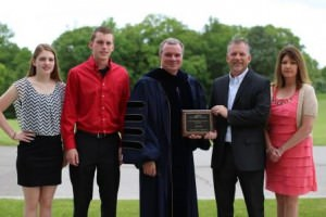 Anthony Kreutz (second from right) received the Outstanding Alumnus Award.  Shown, from left, are his daughter, Kaitlyn; son, Jacob; ECC President Jon Bauer;  Kreutz; and wife, Michelle.  The East Central College Alumni Association established the award in 2002 to recognize outstanding alumni who have set an example for ECC graduates by using their college education and serving their community.  Past recipients include: Tanya Voss, John Griesheimer, Tom Robertson, Chris Manhart, Deborah Koelling, Tammy Watz, Dr. Frank Miller, Ken Schmidt, Chris Stuckenschneider, Ann Schroeder, Ted Coburn, Linda Mahon, Joe Purschke and Amy Wildhaber.   -30-  CUTLINE: Anthony Kreutz (left), a 1999 graduate of East Central College, received the Outstanding Alumni Award at the college's commencement ceremony May 16.  He is shown with Dr. Jon Bauer, ECC president.