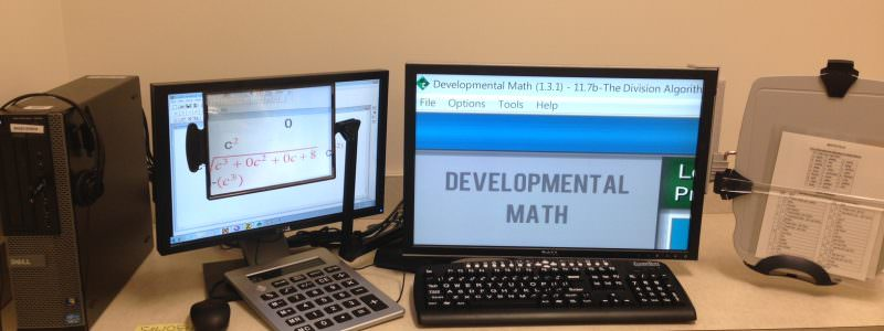 Dual Screen monitors w/ Zoomtext keyboard and extra magnifier. Document holder and talking graphing calculator