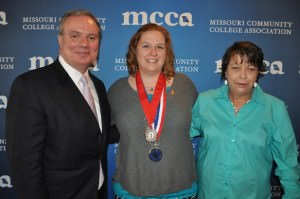 Dawn Little, center, was recently named a Silver Scholar Award recipient by the Coca-Cola Scholars Foundation.   Shown, from left, are Dr. Jon Bauer, ECC president; Little; and Judy Butler, Little's mother.