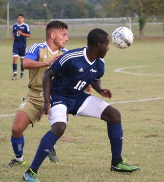 ECC sophomore defender AJ Bannister  and St. Louis Community College's Steve Lilako go for the ball during the September 29 match at ECC.