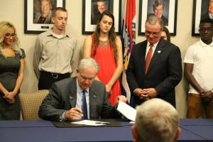 Missouri Governor Jay Nixon signed House Bill 2003 during a visit to East Central College Thursday, April 28, 2016.