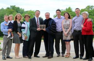 Union attorney Dave Arand (shown center with ECC President Jon Bauer) received the 2016 Outstanding Alumni Award during ECC's spring commencement ceremony May 14. Arand was joined by his family.