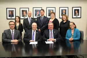 Faculty and staff from St. Louis based Fontbonne University and East Central College were on hand when Fontbonne President J. Michael Pressimone (second from left, seated) and ECC President Jon Bauer (third from left, seated) signed an articulation agreement that will provide more opportunities for ECC students transferring to Fontbonne.