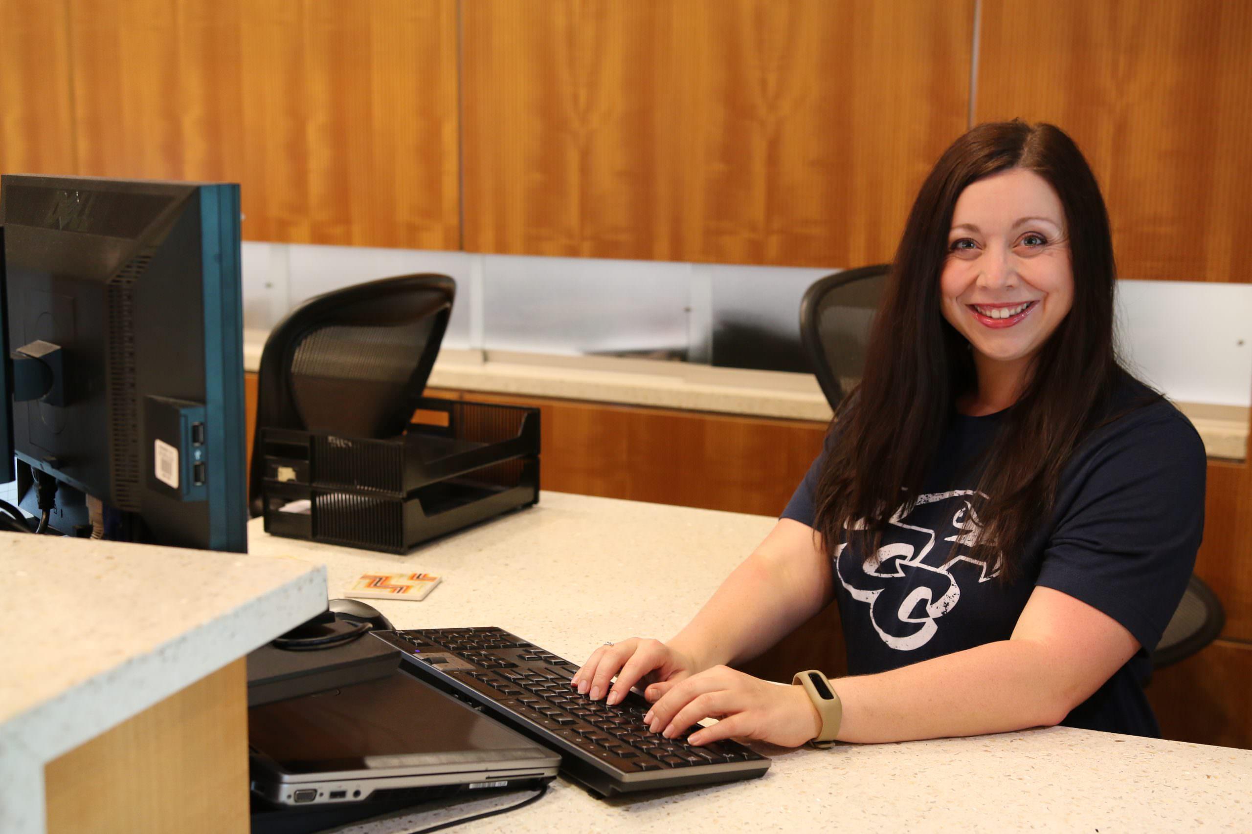 ECC staff member at computer